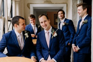 Groom and groomsmen have a beer at the Lord Dudley Hotel