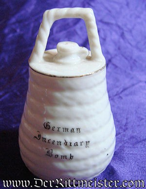 PORCELAIN FIGURINE - INCENDIARY BOMB DROPPED FROM ZEPPELIN - Imperial German Military Antiques Sale