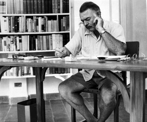 Hemingway_at_his_writing_desk