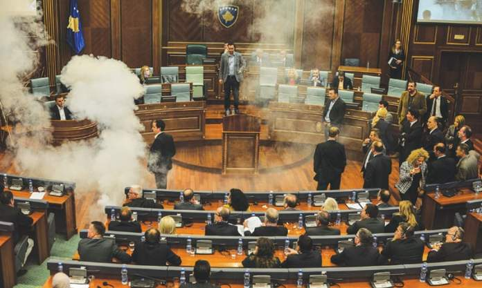 Pristina: A white cloud of tear gas released by opposition lawmakers in Kosovo's parliament rises on Thursday, causing two legislators to faint. The lawmakers were protesting a recent EU-brokered deal reached by the government with Serbia.—AFP