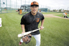 Newly acquired Baltimore Orioles' Everth Cabrera gathers his equipment at the conclusion of a baseball spring training workout in Sarasota, Fla., Wednesday, Feb. 25, 2015. (AP Photo/Gene J. Puskar)