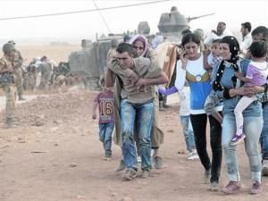 Refugiados Sirios huyen hacia Turquía