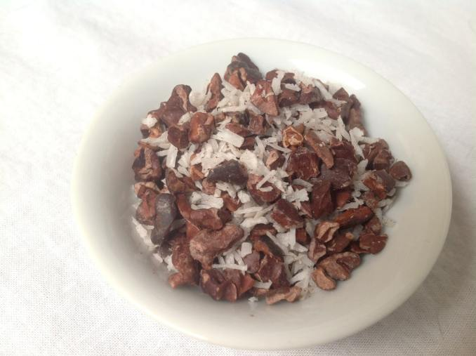 Cacao Nibs and Coconut Flakes in a small bowl
