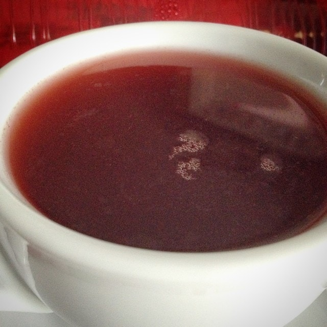 Chocolate Hibiscus Tea, Closeup, Brewed in a White Mug
