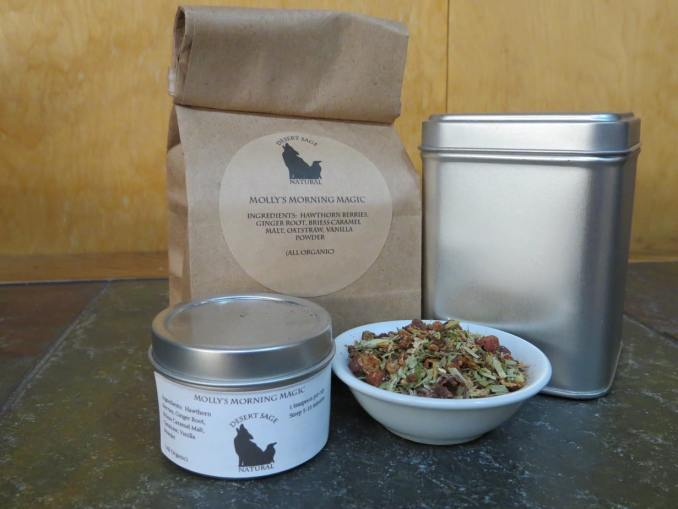 Bag of tea, bowl of tea, tea tin, and a sample tin for Molly's Morning Magic