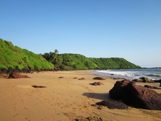 Quiet Cola beach and beautiful hill background, Goa