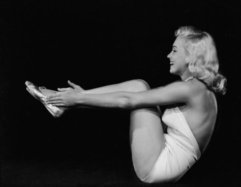 1948: American film star Marilyn Monroe (1926 - 1962) assumes a yogic exercise position. (Photo via John Kobal Foundation/Getty Images)