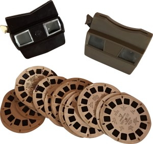 View-Master Stereoscope was patented 1939. A rotating cardboard disk has pairs of images. The center has text.