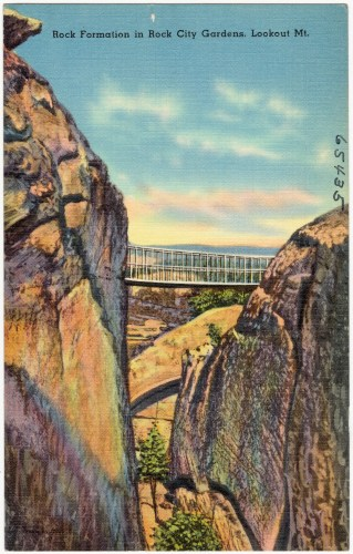 Old Postcard of Rock Formations in Rock City Gardens shows the swinging bridge.