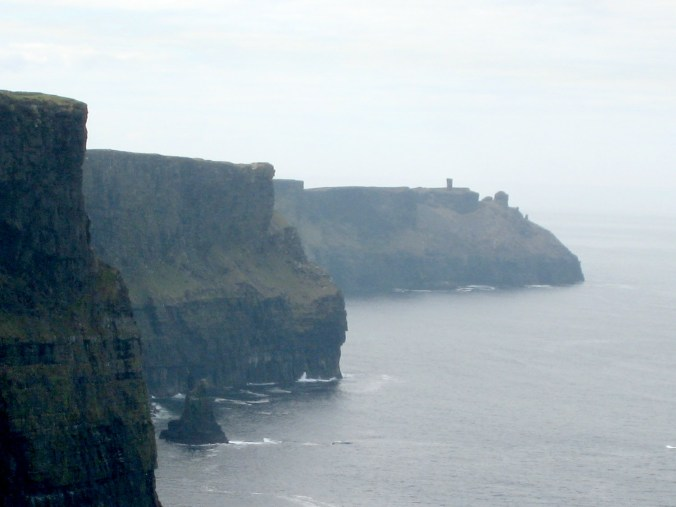Napoleon Tower in the distance from the Cliffs of Moher