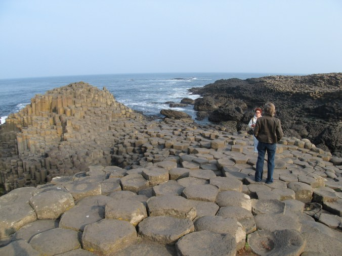Giant's Causeway formed when ancient lava contracted as it cooled, cracking the same way mud cracks when it dries.