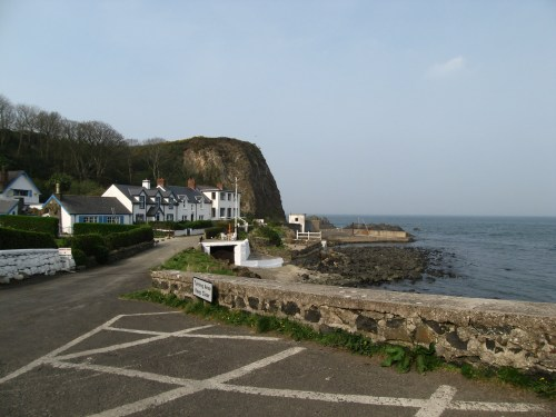 Tiny Portbraddon lies on White Park Bay, on the Antrim Coast between Giant's Causeway and Carrick-a-Rede Rope Bridge.