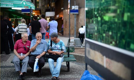 Elderly men sit on a bench in Cinelandia square in Rio de Janeiro. Google wants to do something about ageing. Photograph: AFP/AFP/Getty Images