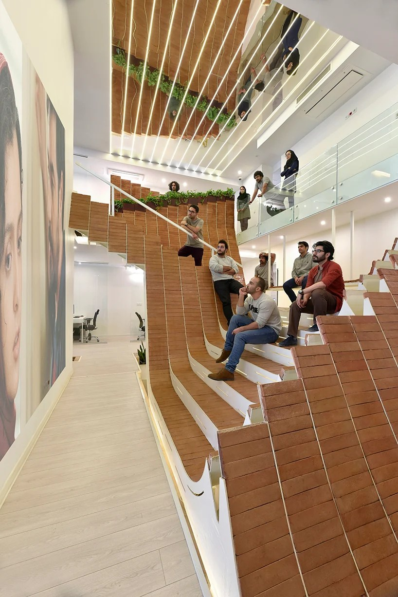 APARAT Headquarters Receives Brick Clad Office Makeover By
