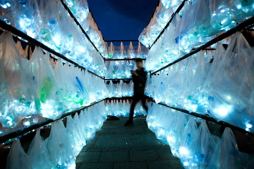 luzinterruptus weaves labyrinth of plastic waste from 6000 illuminated bottles