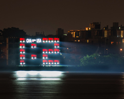 AUDI shipping container scoreboard illuminates with A8 headlights