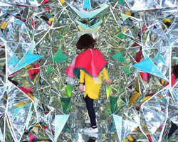 designers turn shipping container into a human-scale kaleidoscope