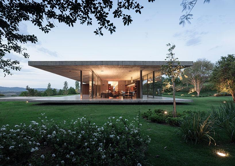 studio mk27 frames the redux house between concrete planes
