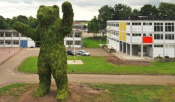 florentijn hofman builds behemoth bear from conifer tree branches