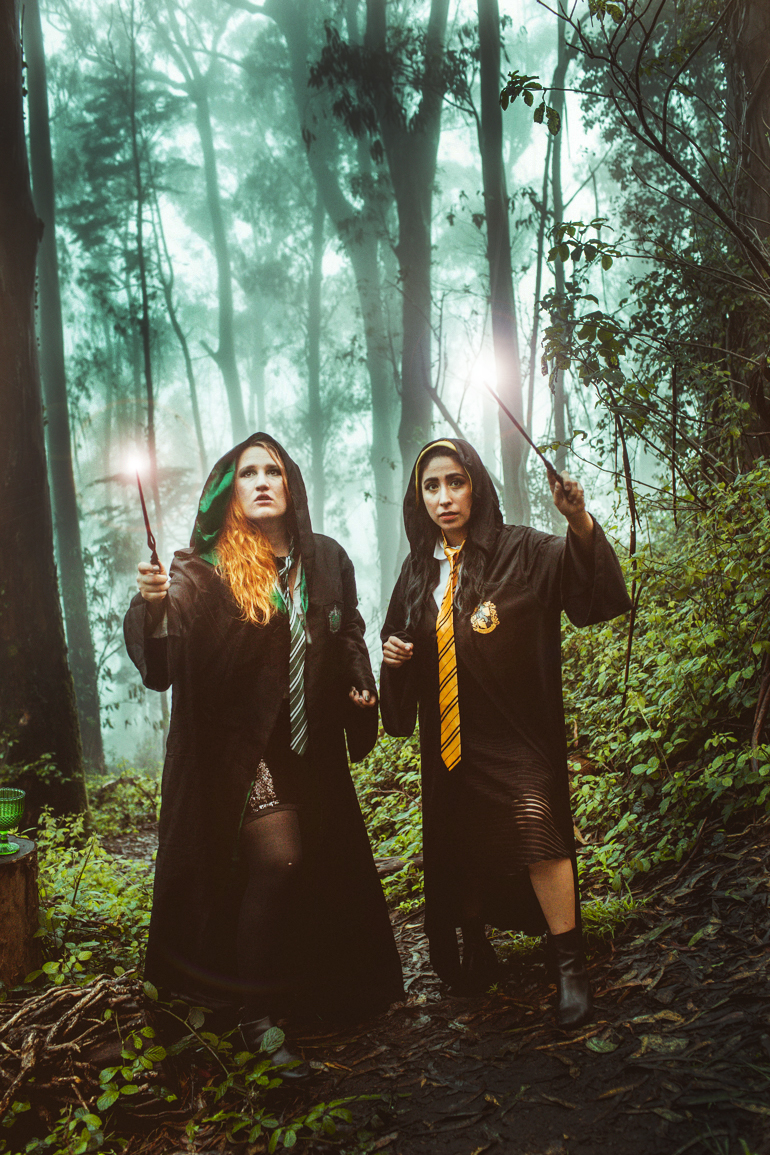 women in hogwarts house robes and wands