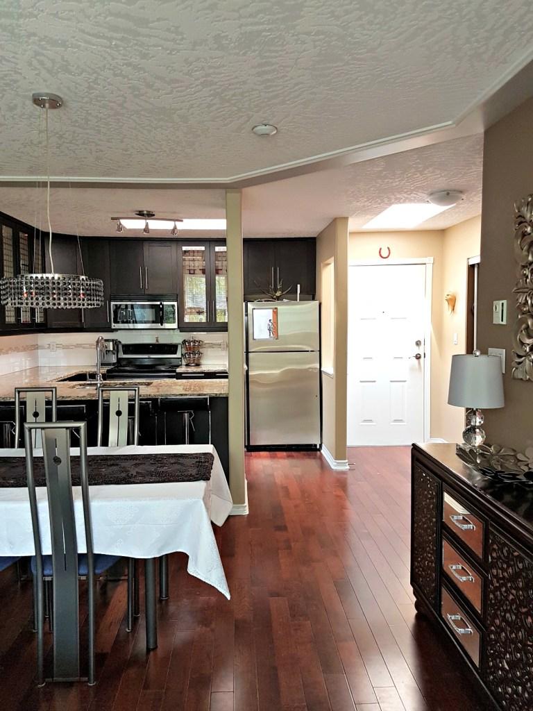 updated kitchen, IKEA kitchen cabinets, brown black cabinets,, dark kitchen cabinets, kitchen makeover, kitchen upgrade, IKEA brown black