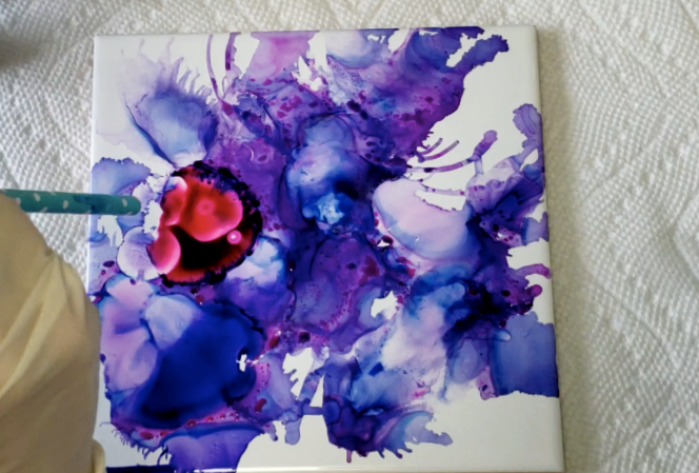DIY alcohol ink coasters on tile. A fun and easy project. Make these for a gift as art as coasters, or just for fun. #alcoholinkcoasters. drop of red