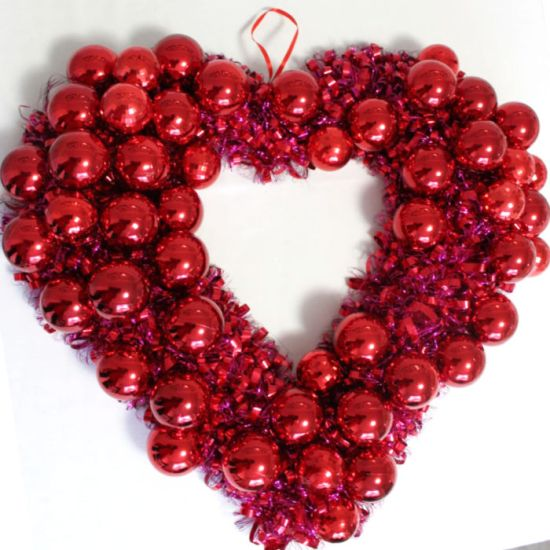 DIY wreath for Valentines Day. Use your left-over Christmas ornaments to make this easy inexpensive Valentines Day wreath in under 2 hours. #valentinesday #DIYwreath