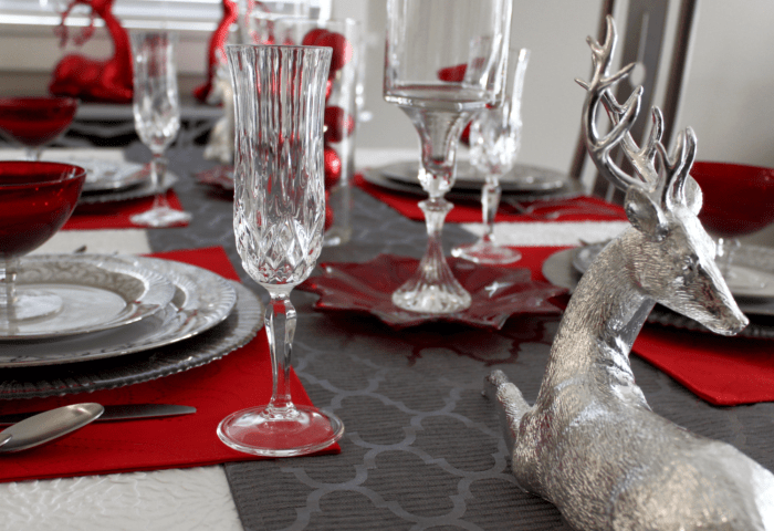 Do you have family Christmas Traditions? Take some of your old traditions and add some new ones of your own. Pick the pieces that you love the best and toss out the rest. #Christmastraditions Christmas Table setting. Red and Silver table setting