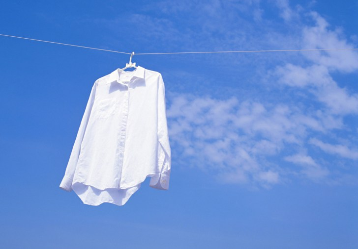 clothes on a clothesline in front of blue sky