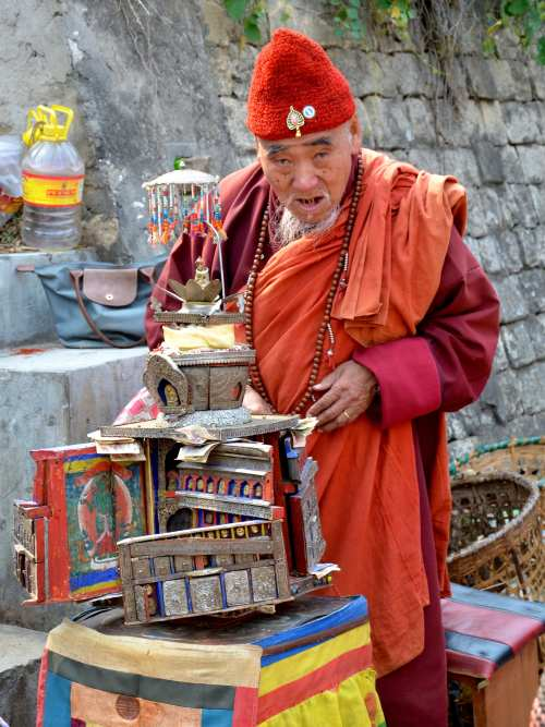 Monk at a market in Bhutan