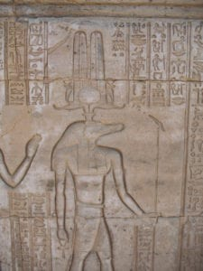The god Sobek surrounded by hieroglyphic messaging