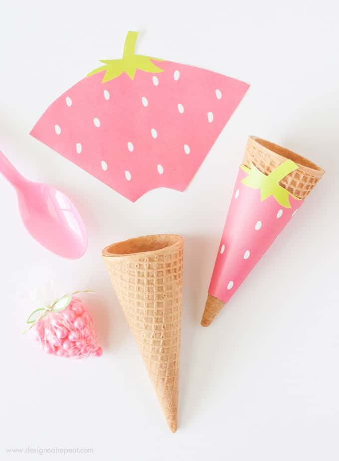 Free Printable Strawberry Icecream Cone Wrappers. Perfect addition to any summer or fruit-themed party!