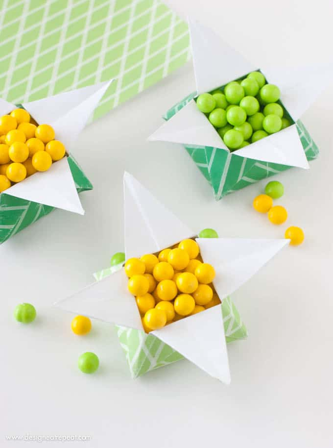 "Looking for a quick St. Patrick's Day craft? Print off this FREE paper & follow the tutorial to make a origami ""Pot of Gold"" box. Fill with candy for a fun project you can make at home!"