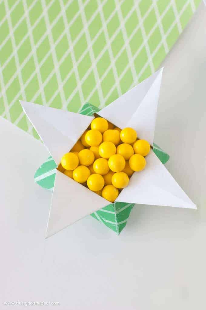 "Looking for a quick St. Patrick's Day craft? Print off this FREE paper & follow the tutorial to make a origami ""Pot of Gold"" box. Fill with candy for a quick & fun project you can make with things you already have at home!"