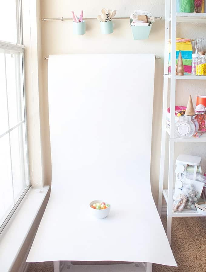 Love this idea for blog photography backgrounds! Get a large roll of white paper & hang it on a curtain rod!
