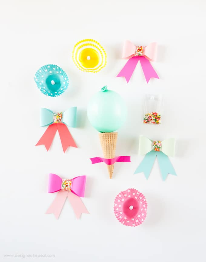 Use this free printable template to make these adorable DIY Paper SPRINKLE bows! Great for birthdays, holidays, or just to gift fun supplies to your favorite baker! Easy & fun!