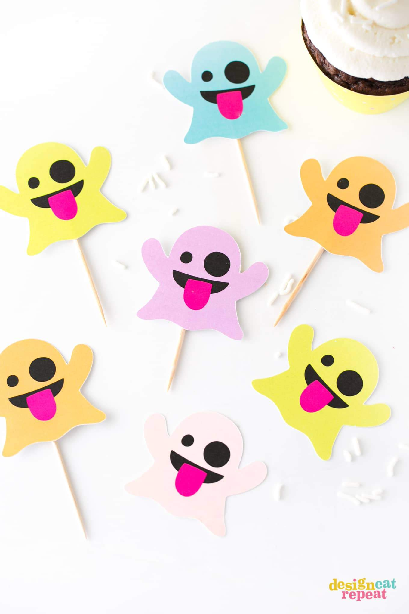 Emoji Ghost Halloween Cupcake Toppers! Free to download and print at www.DesignEatRepeat.com #Halloween #Printable #Cupcake #Emoji
