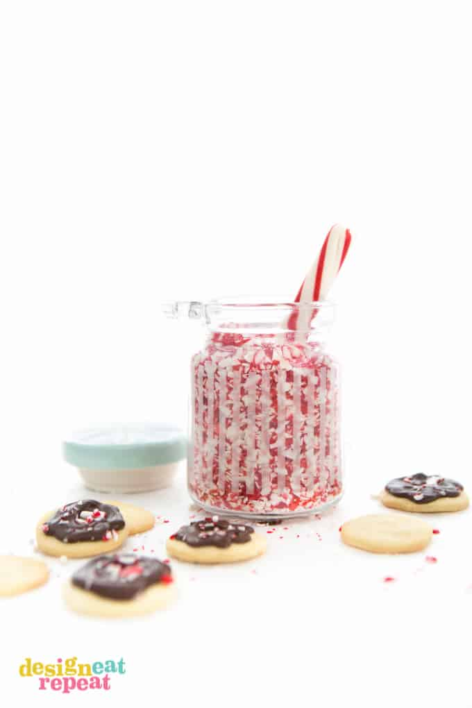Peppermint butter wafers and jar of crushed peppermint candy.