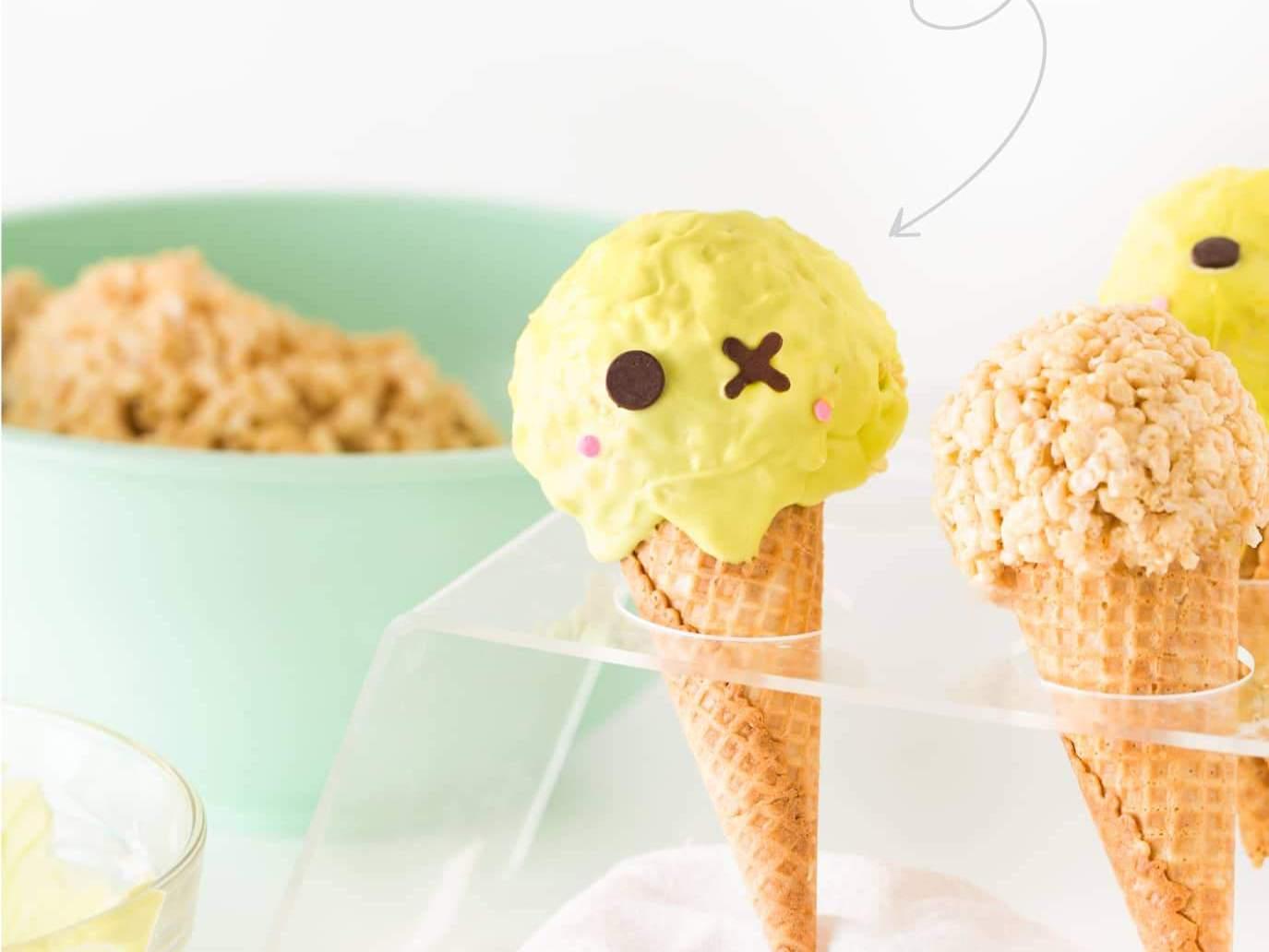 Cute Zombie Halloween Rice Krispie Treats in plastic ice cream cone holder.