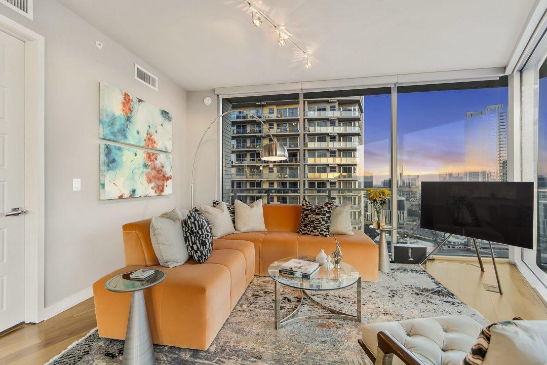 family room with orange sectional, Lenore, Austin Interior Designer