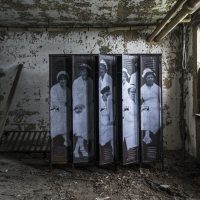 UNFRAMED Photo Exhibition in the abandoned Ellis Island Hospital by street artist JR