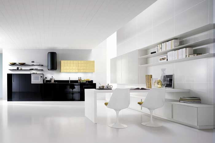 The Manhattan black glossy lacquered kitchen is the anchor of this studio living space.