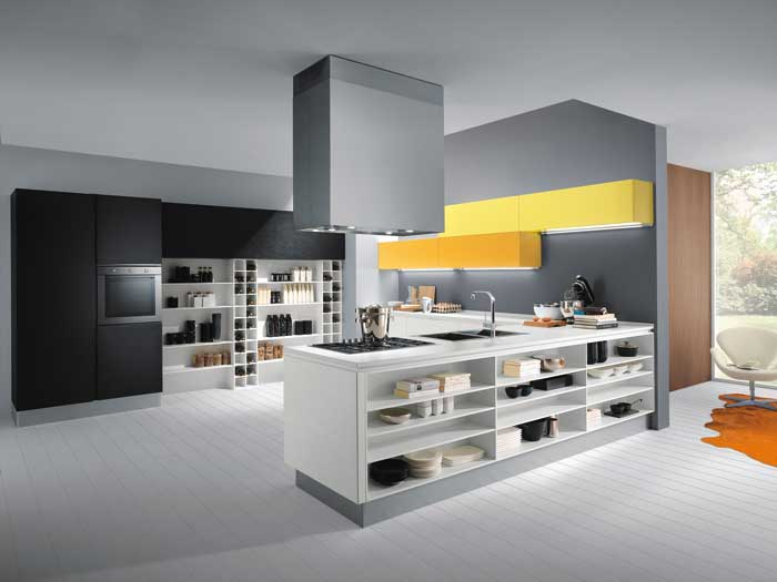 In this Mya kitchen, monochrome is enlivened with high accent colour.