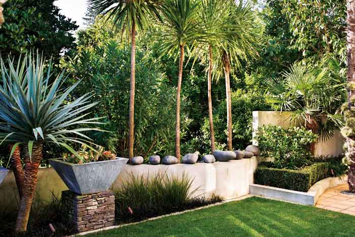 A lawn provides a restful balance to structural features.