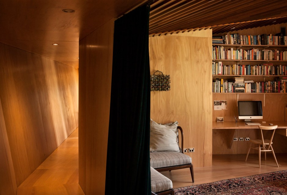 The study and second lounge are screened by velvet curtains