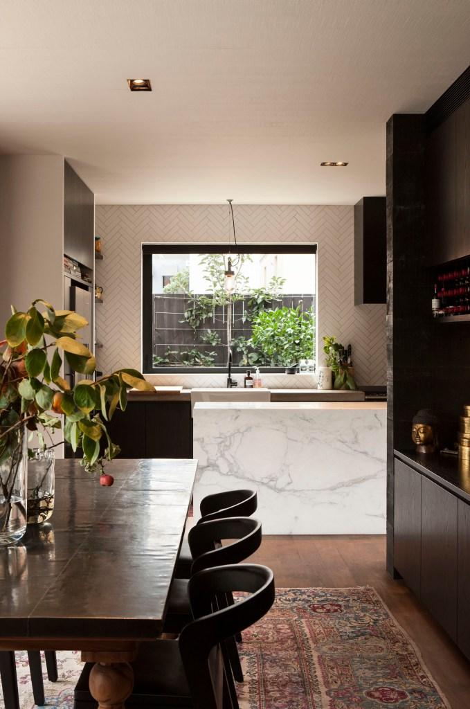 Richard Naish suburban house view through dining room to kitchen
