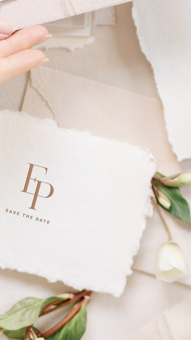 modern save the date with deckled edges and classic wedding logo feature with initials E and P