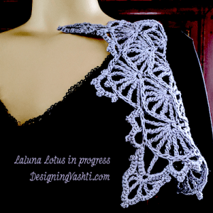 Lotus yarn in Lavender Ice shown in baroque looking tall stitch fans on a mannequin.