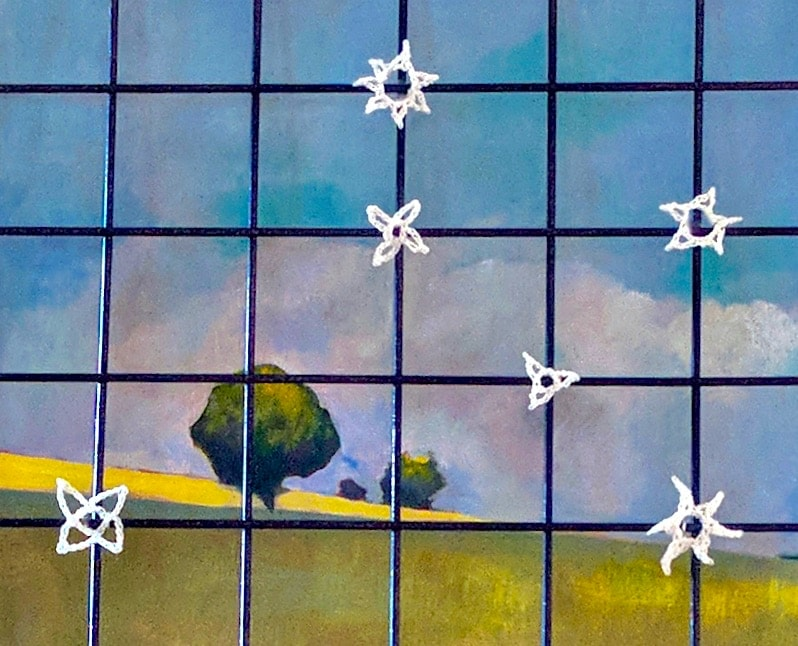 wire mesh panel decor with unique crochet stars and an original painting as a backdrop