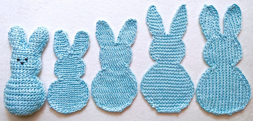 Five marshmallow-candy-shape bunnies lined up from shortest (3 slip stitch) to tallest (2 Tunisian crochet)